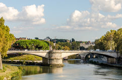 Quay of the river Tiber in Rome, Italy and the bridge across it, floating on the river excursion boat for tourists Royalty Free Stock Photo