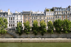 Quay of Seine in Paris. Famous quay of Seine in Paris with trees and buildings Stock Photography
