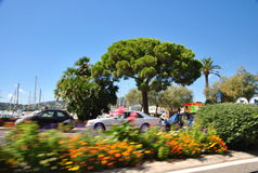 Quay in summer colors in Saint-Tropez - view from a moving car. Photography from a moving car with blur background on the quay in Saint-Tropez on a clear summer Royalty Free Stock Photography
