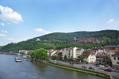 Quay, traffic and barges in the river in summer Heidelberg. Quay, traffic and barges in the river and quay of european city in summer Heidelberg Royalty Free Stock Images