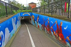 The Quay Underpass Exeter, as it descends towards the River Exe. The graffiti is very bright and colourful Stock Photos