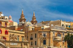 Ancient fortifications of Valletta, Malta. Quay of Valletta with traditional Maltese building with colorful shutters and balconies in the sunny day, Valletta Royalty Free Stock Photography