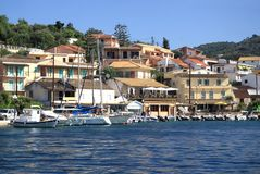 Quay of the village of Kassiopi is a tourist village in the nort Stock Photos