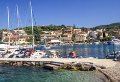 Quay of the village of Kassiopi is a tourist village in the nort Royalty Free Stock Photos