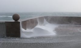 Quay in winter, descent to the water, snow drift. Picture of a snowy corner on the bank, cold sea, cold wind, the middle of winter Royalty Free Stock Photography