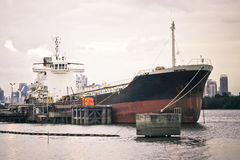 Quayside. The cargo ship mooring at the harbour royalty free stock photos