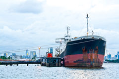 Quayside. The cargo ship mooring at the harbour royalty free stock photography