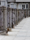 Quayside bollards berths and pavement Stock Photography