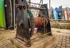 Quayside Cable Winch. A cable winch found on the quayside of the harbour. Used for lifting boats out of the water Royalty Free Stock Image