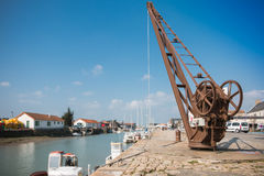 Quayside crane of Noirmoutier Royalty Free Stock Images