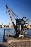Quayside Crane. Old port crane on a pier in the harbor of Copenhagen Royalty Free Stock Photo