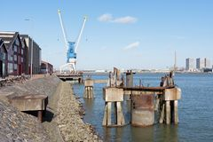 Quayside with factory buildings and crane Royalty Free Stock Photo
