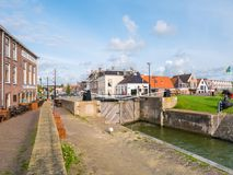 Quayside and old ship lock in historic town of Makkum, Friesland. Quayside and 17th century old ship locks in historic town of Makkum, Friesland, Netherlands Stock Images