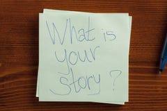 Que é sua história? escrito em uma nota fotografia de stock royalty free