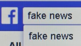 ` Que mecanografía del pixel del nivel del usuario macro de la opinión ` falso de las noticias en la barra de la búsqueda en Face almacen de video