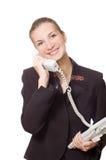 Que sonríen los negocios a mujeres hablan en el teléfono Imagen de archivo