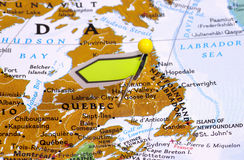 Quebec. Pin in a Map Locating Quebec Stock Photography