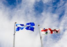 Free Quebec And Montreal Flags On Sky Royalty Free Stock Photo - 151347775