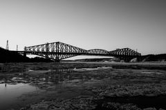 Quebec bridge on sunset. Black and white picture of Quebec Bridge on sunset. Cold sunny day of january Royalty Free Stock Photos