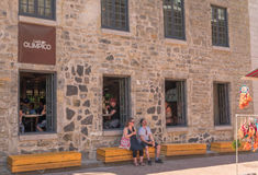 Old Montreal, Canada, Street photography. Tourists and diners with beautiful cobblestone street royalty free stock image