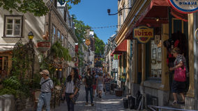 Quebec, Canada, Street photography. Tourists and diners with beautiful cobblestone street stock photo