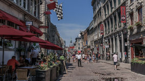 Quebec, Canada, Street photography. Tourists and diners with beautiful cobblestone street royalty free stock image