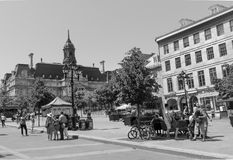 Old Montreal,Quebec, Canada, Street photography. Tourists and diners with beautiful cobblestone street in black and white stock image
