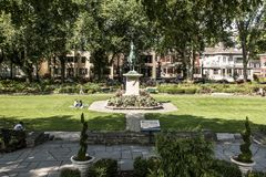 Quebec City 13.09.2017 Bronze statue Sancta Joanna D arc - Joan of Arc war memorial in a colorful garden on a sunny day Royalty Free Stock Image
