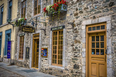 Quebec City, Canada, charming stone building. Colorful buildings on the cobble street of old town stock image