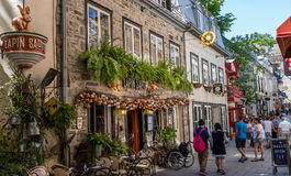 Quebec City, Canada, Street photography. Colorful restaurants with beautiful decor and people strolling the street royalty free stock photos