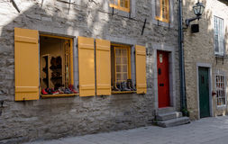 Quebec City, Canada, Street photography. Colorful windows displaying shoes on the street royalty free stock images