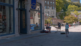 Quebec City, Canada, Street photography. Musician playing on the beautiful street of the city stock photo