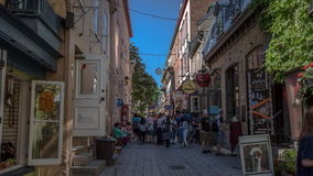 Quebec City, Canada, Street photography. Shoppers strolling the cobblestone streets royalty free stock image
