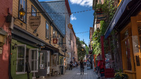 Quebec City, Canada, Street photography. Tourists and shoppers strolling the cobblestone streets stock photography
