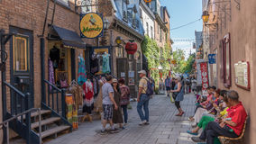 Quebec City, Canada, Street photography. Tourists and shoppers strolling the streets stock image
