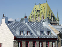 Quebec City Roofs. The roof of the Chateau Frontenac towers over a house in Old Quebec City, Quebec, Canada stock photo