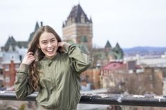 Quebec City scape with Chateau Frontenac and young teen enjoying the view. Royalty Free Stock Photos