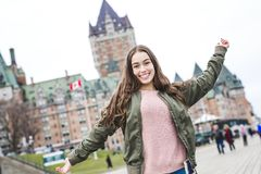 Quebec City scape with Chateau Frontenac and young teen enjoying the view. A Quebec City scape with Chateau Frontenac and young teen enjoying the view stock images