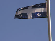 Quebec flag. Quebec provincial flag flying in the wind (with room for text stock photo