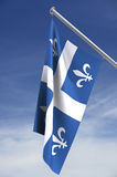 Quebec flag with clipping path. Hanging from pole with sky in background royalty free illustration