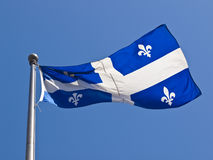 Quebec Flag Flying Royalty Free Stock Images