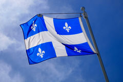 Quebec Flag pole on blue sky national st-jean banner Stock Photo