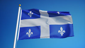 Quebec flag in slow motion seamlessly looped with alpha. Quebec flag waving in slow motion against blue sky, seamlessly looped, close up, isolated on alpha