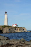 Quebec, the lighthouse of Cap les Rosiers in Gaspesie Royalty Free Stock Photos