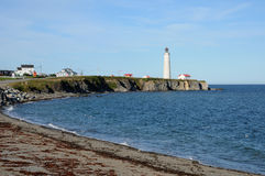 Quebec, the lighthouse of Cap les Rosiers in Gaspesie Royalty Free Stock Photo