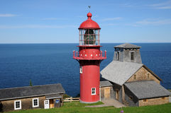Quebec, the lighthouse of Pointe a la Renommee in Gaspesie Royalty Free Stock Image