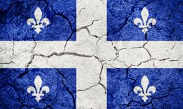 Quebec, province of Canada, flag. On dry earth ground texture background stock photo