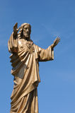 Quebec, a statue of Jesus in the village of Baie des sables Royalty Free Stock Images