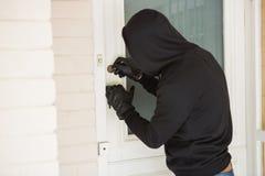 A quebra do assaltante abre a porta imagem de stock