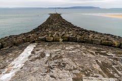 Quebra-mar de pedra Fotos de Stock Royalty Free